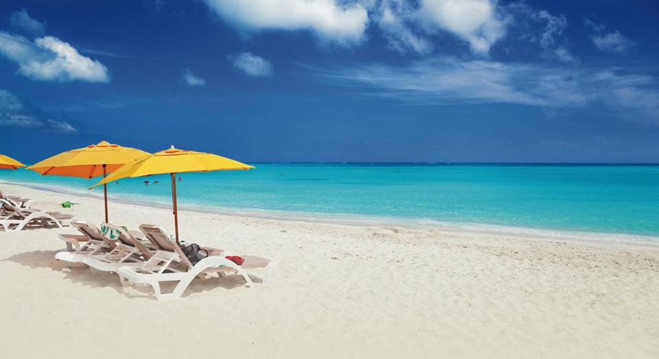 You Could Be Sitting Pretty On The Beach At Turks And Caicos If You Book A